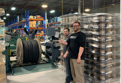 Photo caption: OmniCable Toronto branch's employees are excited about their first order!! (OmniCable Toronto employees from left to right, Kevin Millington, Distribution Center Floor Lead; Sean Weir, Distribution Center Floor Lead; Adan Evanson, Distribution Center Manager)